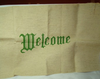 1988 Counting Cross stitched WELCOME .