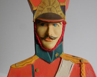 Vintage Candy box Soldier shaped Clay face sword dimensional figure 19 inch figural orange case