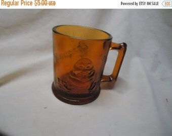 "August Blowout Sale Vintage Amber ""Humpty Dumpty & Tom Tom the Piper's Son Glass Mug, collectable. brown"