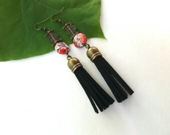 Large, African brass pendant earrings//dramatic drop dangle earrings//leather tassel earrings