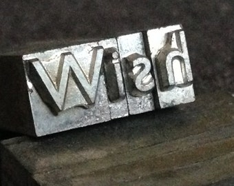Wish. Vintage letterpress printing blocks word spelling.