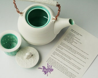 Handmade porcelain teapot with strainer and chai recipe