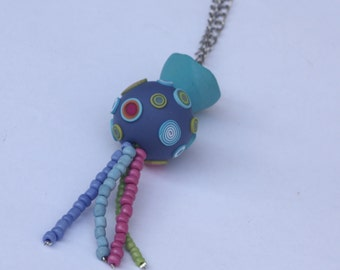 Long necklace with a purple-blue decorated ball, polymer clay