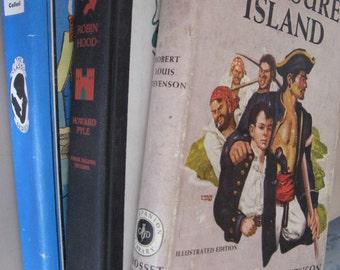 Three Novels Treasure Island by Robert Louis Stevenson Pinocchio by C Collodi and Robin Hood by Howard Pyle