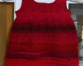 Dress/pinafore/tunic for a baby girl age 6-12 months.  Hand knitted in red wool rich yarn  size approx 20-21 inch chest