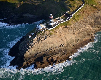 the oldhead lighthouse from the air a little after sunrise