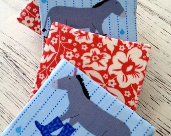 Set of Four Fabric Covered Coasters with Donkeys and Red Flowers