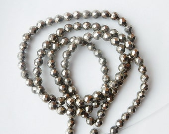 6mm Pyrite  faceted round beads.  fool's gold