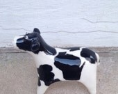 cow with Wisconsin on its sides, ceramic mini sculpture