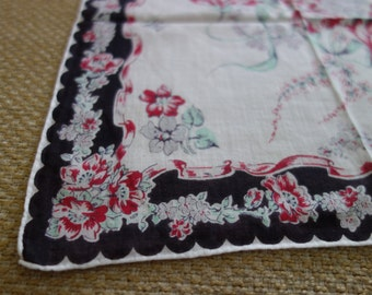Bold black bordered hankie with red green lilac floral accent