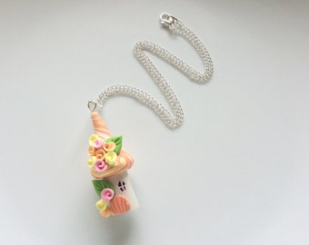 Fairy house necklace in peach and pink colours handmade from polymer clay