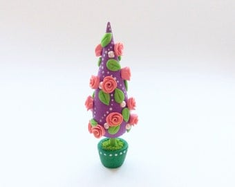 Miniature Christmas tree with pink roses and green leaves handmade from polymer clay