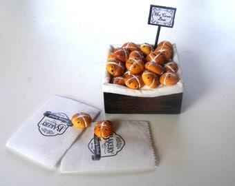Hot cross buns in a bakery box