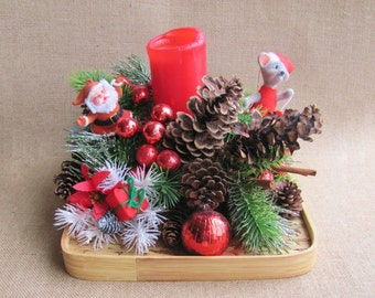 Vintage Christmas Arrangement With Red Candle, Glass Ornaments, Plastic Santa, Skiing Mouse, Pine Cones, Plastic Pine Branches