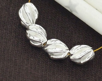 4 of Karen Hill Tribe Silver Twist Oval Beads 7x8 mm. :ka3566