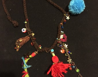 Handmade knitted necklace finished with charms