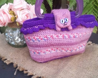 Lilac and purple Crocheted Sausage Cats handbag, with knitted Cat fastener.