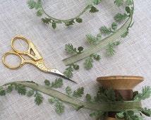 Oak leaf edged ribbon trim with sheer center.
