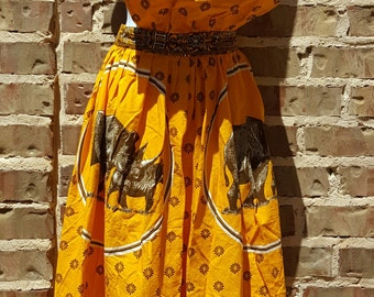 David Whitehead Textiles. Zimbabwe. Cotton Pinafore Dress. Rhinoceros. Med