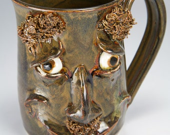 Brown glazed happy face mug