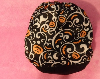 SassyCloth one size pocket diaper with pumpkins and swirls PUL print. Ready to ship.