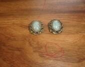 vintage clip on earrings goldtone blue glass marbled rhinestones