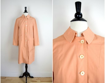 "Vintage Misty Harbor ""any weather coat"" / peach pink rain jacket / trench style button front coat with orange lining"