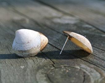 clam in gold earrings.