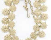 Beautiful Vendome necklace of linked gold tone filigree flowers