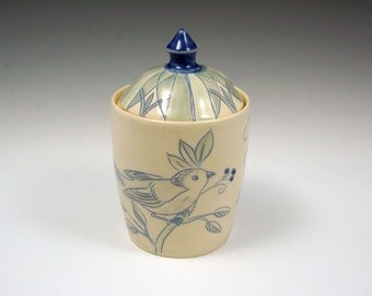 Ceramic lidded storage jar with blue bird and berries