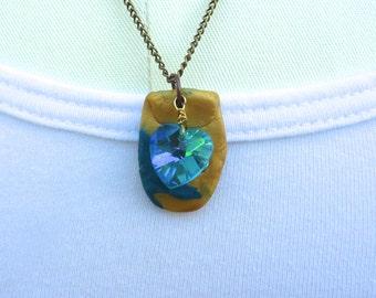 Teal Heart Polymer Pendant Necklace, Primitive Art Necklace, Swarovski Crystal, Brass Necklace. Shield Pendant