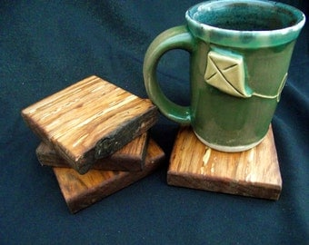 Natural Set of four coasters or serving plates live edge wood reclaimed organic figured maple