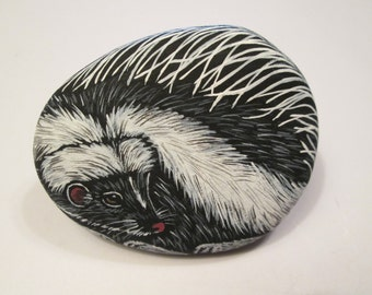 Skunk hand painted on a stone - pet rock - by Ann Kelly
