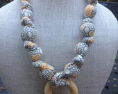 Gray and orange whimsy teething and breastfeesing necklace