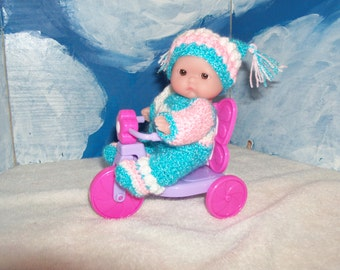 Little 5 Inch Doll in a Crocheted Jester Outfit with his Tricycle