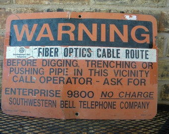 SWB buried cable sign converted to fiber optics sign fun sign of our progress