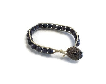 Black shell wrap bracelet button