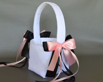 White lace wedding flower girl basket with light pink and black ribbons