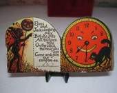 1920's Beistle halloween party invitation elf holding a jack o'lantern on stick , black cat ,clock with face