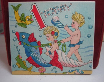 Adorable unused colorful 1930's-40's 1st birthday card underwater fantasy scene of young water nymphs riding in large shells blowing bubbles