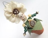 Garden Sprite, mixed media assemblage, flower girl, millinery flowers, cicada ornament, altered art doll, by Elizabeth Rosen