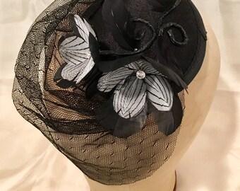 Handmade Edward Gorey inspried feather Magnolia fastinator with vintage silk black veil.