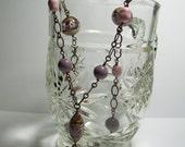 Purple Roses Venetian Glass Necklace. Brass Oxide Chain Necklace. Murano Glass and Swarovski Crystals. Venetian Glass Pendant Necklace.
