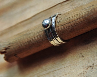 Three sterling silver hammered stacking rings with silver ball