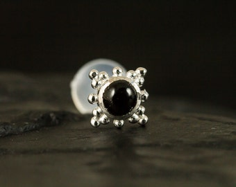 Black CZ Cabachon with cluster trinity ball push in 16g bio flexible tragus / cartilage / conch ear piercing