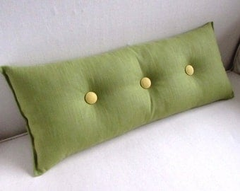 decorative lumbar pillow in PEAR GREEN with yellow buttons