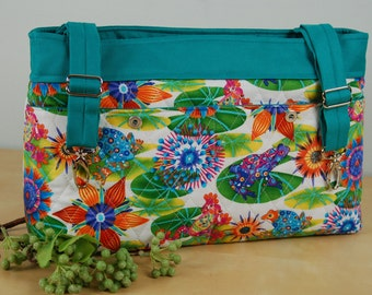 Powerchair - Walker Bag:  Splashy and Fun quilted print with Flowers and Frogs.  Turquoise lining features water resistant fabric.