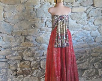 Mans sequinned strapless dress with red and green silk sari print skirt with matching gold sequinned pants