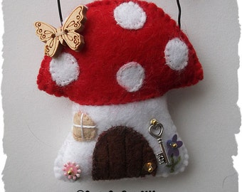 Fairy Toadstool House felt hanging ornament.