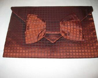 Handmade 100% silk burnt orange envelope cluth, with black plaid